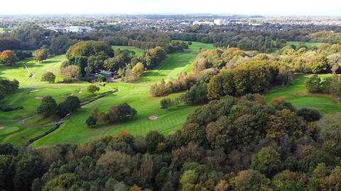 Aerial Overhead Drone Shot flying over UK Golf Course and Forest (4K) Live Action