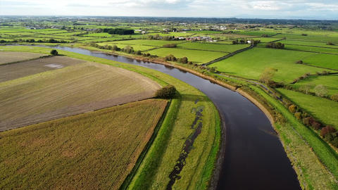 Overhead Aerial Drone Shot Rising over River and Fields in UK Countryside (4K) Live Action