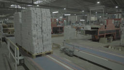 The movement of the packaging of the product on the conveyor belt Live Action