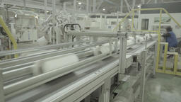 A large working conveyor belt in a factory in the production process Live Action
