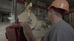 The man working at the plant (factory) during production Footage