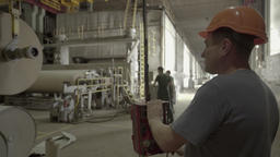 Worker works in a factory Footage