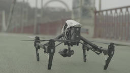 Drone with camera flies up from the ground ビデオ