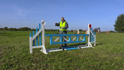 Horse handler take picture of hurdle Footage