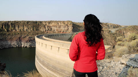 Asian woman hiking near the Salmon Falls Dam in Southern Idaho Live Action