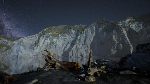 hyperlapse of night starry sky with mountain and ocean beach in Lofoten Norway Live Action