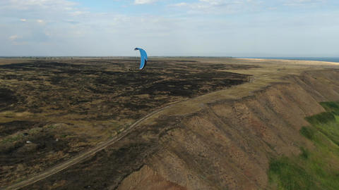 Beautiful view on the sea and people paragliding, extreme sports Live Action