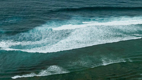 Huge waves rolling one by one to coastline surfer try to catch wave Live Action