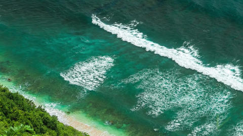 Aerial view of waves rolling one by one to the nunggalan beach near uluwatu bali indonesia Live Action