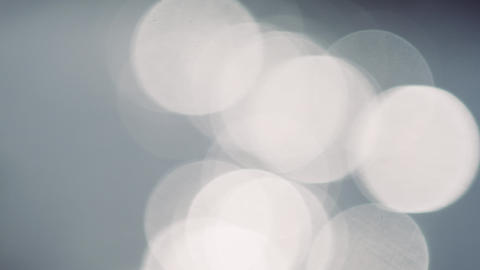 Big abstract playing water surface sun bokeh light particles glittering in the sun Live Action