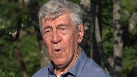 Elderly Man Posing Outdoors Live Action
