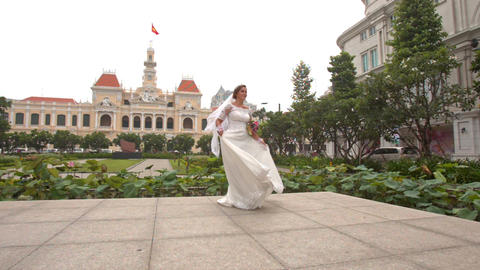 Bride in Long Turns around on Square in Saigon in Vietnam Footage