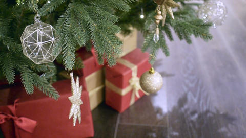 New Year's and Christmas tree decoration in shopping mall whith gift box Footage