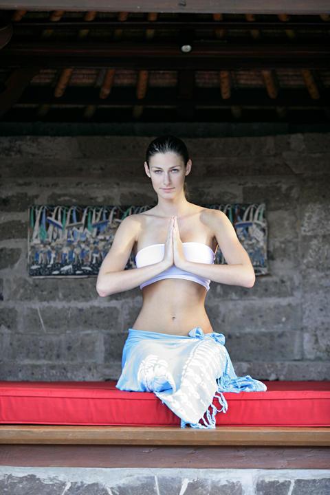 Young woman doing yoga pose ภาพถ่าย