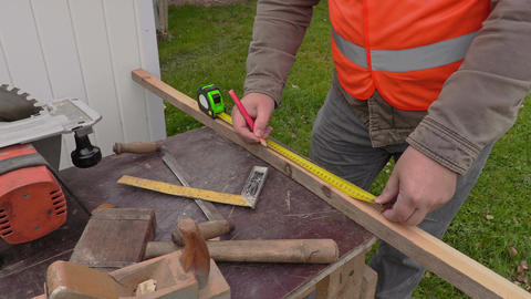Carpenter using tape measure Footage