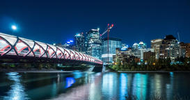 Motion Time Lapse of the Peace Bridge at night in Calgary, Alberta Footage