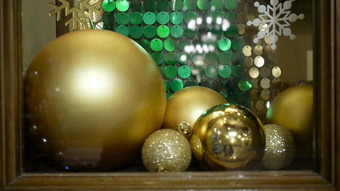 Close-up New Year's and Christmas decorations in window. Gold balls Footage