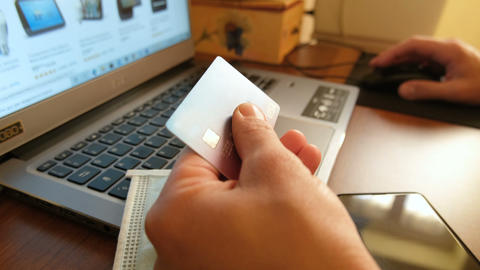 Man using visa credit card for web payment on laptop,tech e-commerce business Live Action