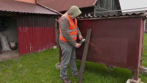 Worker using grinding machine Footage