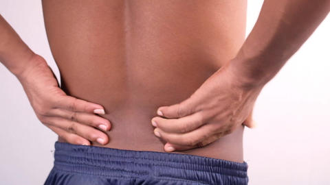young man suffering back pain close up Live Action