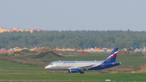 Aeroflot - Russian Airlines Sukhoi Superjet 100 regional airliner taxiing to Live Action