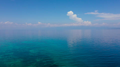 Tropical blue sea and blue sky with clouds. Mountains on the horizon Live Action