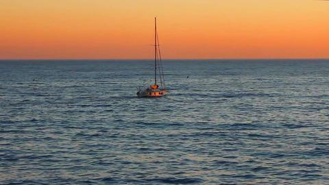Sailboat At Sunset in Mediterranean Sea Footage