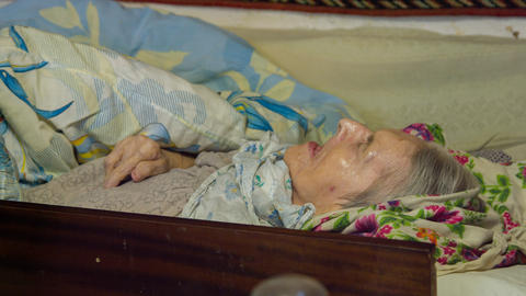 Sick old woman laying in bed Live Action