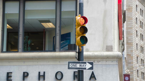 Yellow traffic light changes to red light green Footage
