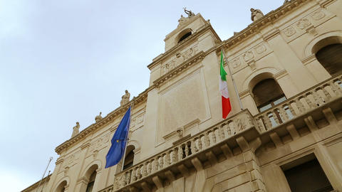 Italian and European flags on the historic building of Town Hall of Padua Footage