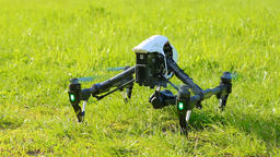 Drone takes off with green grass up, composed chassis and flies up out of frame Footage