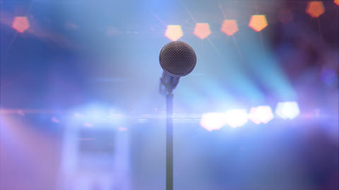 Microphone on the stage in the concert hall against the shining stage lights Live Action
