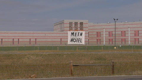 A handmade sign outside a prison reads Meth Hotel Stock Video Footage