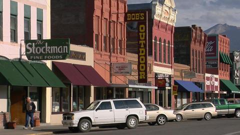 People walk along a street in a quaint Western town Stock Video Footage