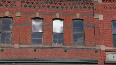 Windows and colored patterned bricks on a building Footage