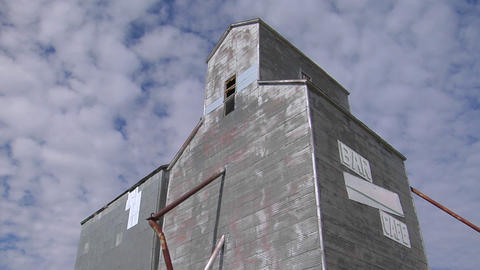 """An abandoned grain elevator with a sign saying Bar/Cafe""""... Stock Video Footage"""