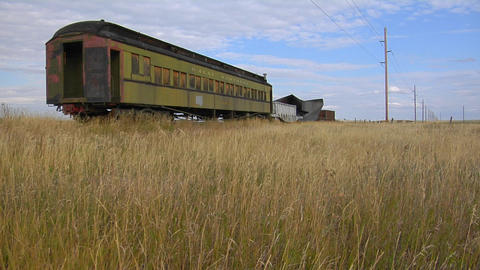 An old abandoned Pullman railway car sits on a siding along a lonely stretch of railroad track Footage