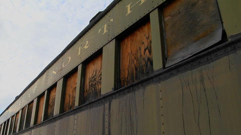 An old abandoned Pullman railroad car is boarded up Stock Video Footage