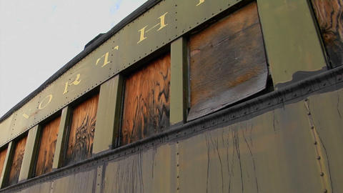 An old abandoned Pullman railroad car is boarded up Footage