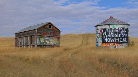 An old abandoned house and water tower with graffiti... Stock Video Footage