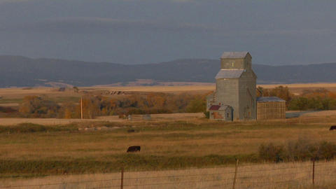 A grain silo stands on the open prairie Footage