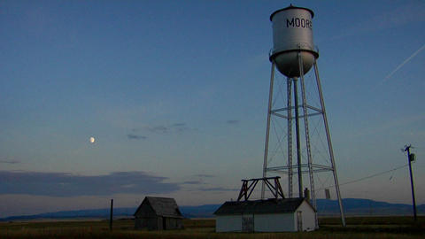A water tower stands on the prairie Footage