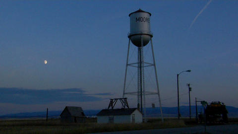 a water tower stands in a small town Stock Video Footage