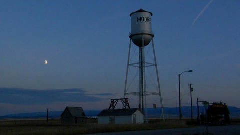a water tower stands in a small town Footage