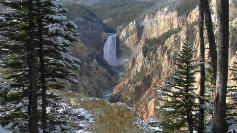 A waterfall cascades down the Grand Canyon of Yellowstone... Stock Video Footage