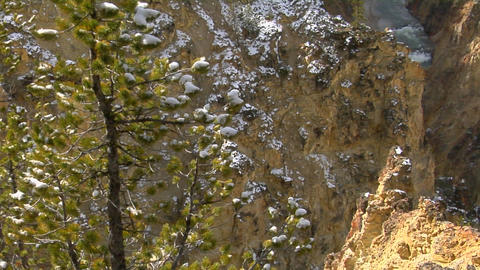 A waterfall flows down a mountainside in Yellowstone... Stock Video Footage