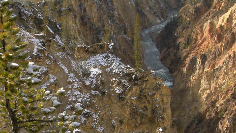 A waterfall flows down a mountainside in Yellowstone National Park Footage