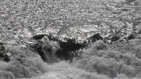 Water tumbles over rocks in a river Stock Video Footage