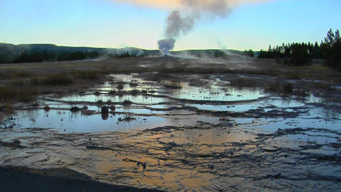 A geyser sends steam into the sky at Yellowstone National... Stock Video Footage