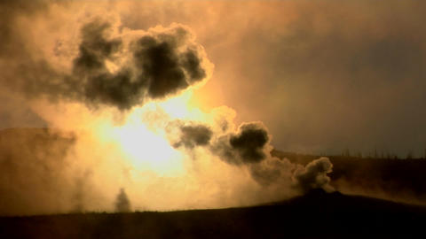 Dark clouds rise from a volcanic eruption in a geothermal area of Yellowstone National Park Footage